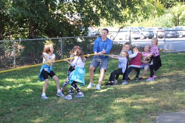 HAVING FUN FUNDRAISING: P.E. teacher Josh Procaccianti joined grade 2 students in the tug of war battle.
