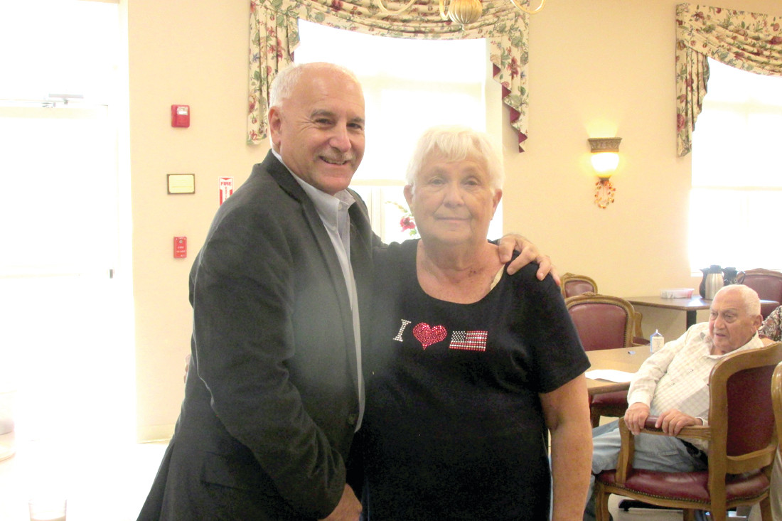 PREXY'S PAL: Lori DeVito, veteran president of the Manton Seniors, is joined by her long-time friend Mayor Joseph Polisena at last week's luncheon.