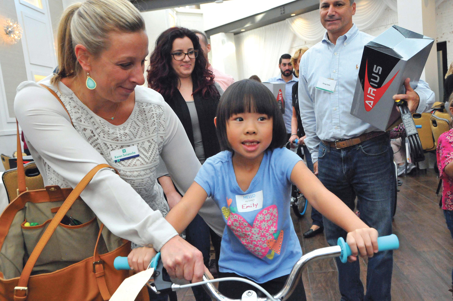 READY TO RIDE: Karen Swiatocha makes sure that first grade student Emily has her balance.