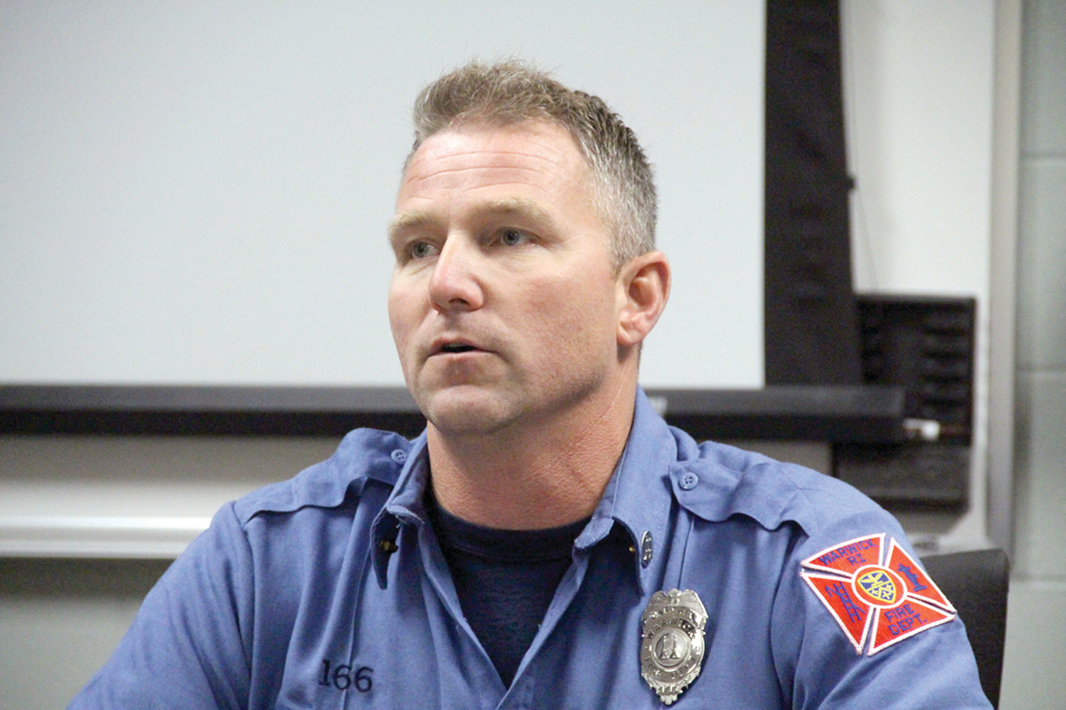 HE'LL BE TRAINING: Captain Michael Mernick of the division of training talked about the rigorous 18-week training program recruits must complete to become probationary firefighters.