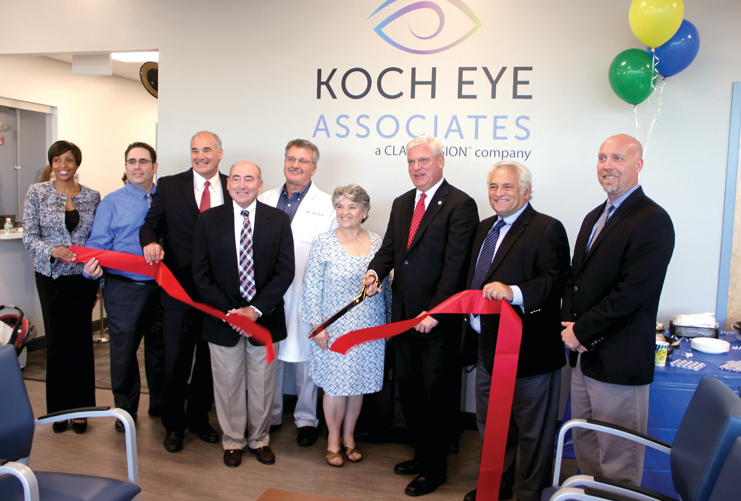 OFFICIAL CUT: Mayor Scott Avedisian snips the ribbon at the official opening of new Koch Eye Associates offices on Greenwich Avenue Tuesday evening.