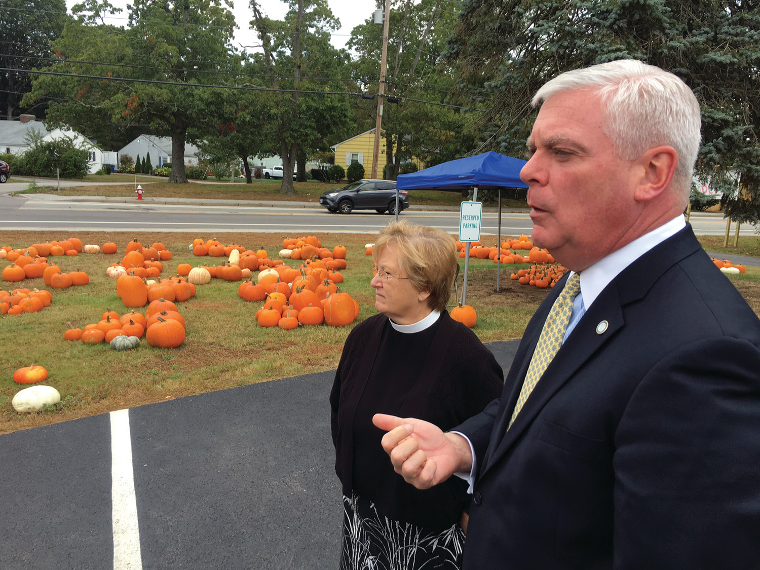 PUMPKIN PROS: Mayor Scott Avedisian and Mother Susan Wrathall survey the new crop of pumpkins for this year's fundraising pumpkin patch.