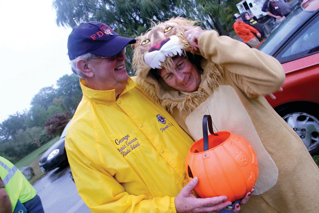 CHIEF LION: Nancy Phillips, district governor of the Lions Club, was appropriately dressed as a lion for Saturday's event at the Oakland Beach Commons. The district is comprised of 30 clubs with a total membership of 1,100. Service efforts of the Lions Club focuses on vision – the Warwick club collected 7,000 pairs of used eyeglasses last year that go to needy people around the world – diabetes, children's cancer and hunger. With Nancy is George Areson, past district governor and president of the Warwick club.