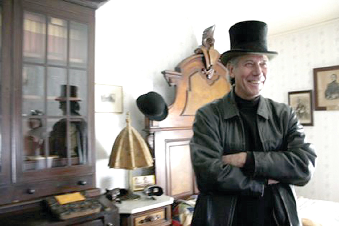 MADNESS IN THE MIRROR: In 2005, Kennedy and Bell met for an interview at Sprague Mansion. Kennedy asked Bell to put on a top hat that was on the bed for a profile photograph. Yet, a woman appeared in the mirror dressed in clothing of the 1880s, on film. Bell is a folklorist and author, and retired folklorist for the State of Rhode Island. Kennedy has been a reporter with the Cranston Herald for more than two decades.