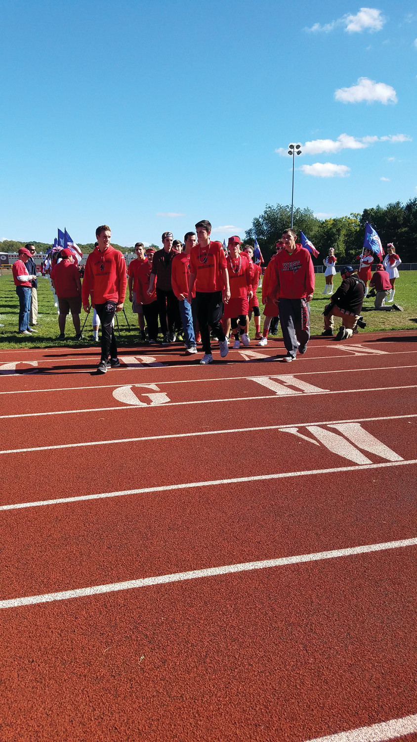 KEEP ON RUNNING: The Cranston West Boys Cross Country team was one of the fall sports teams spotlighted on the field at last week's pep rally.