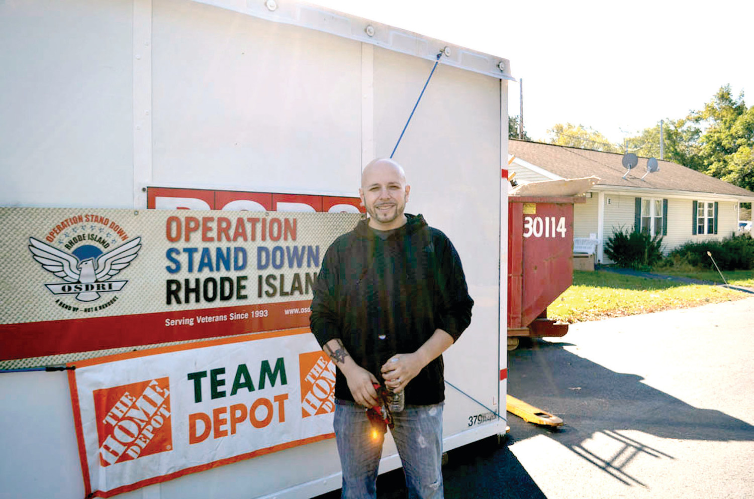 "VALUABLE VOLUNTEER: Errol Ruginski, the ""Team Depot"" captain for the Warwick Home Depot store, volunteered at Operation Stand Down Rhode Island to make improvements to veterans' housing."