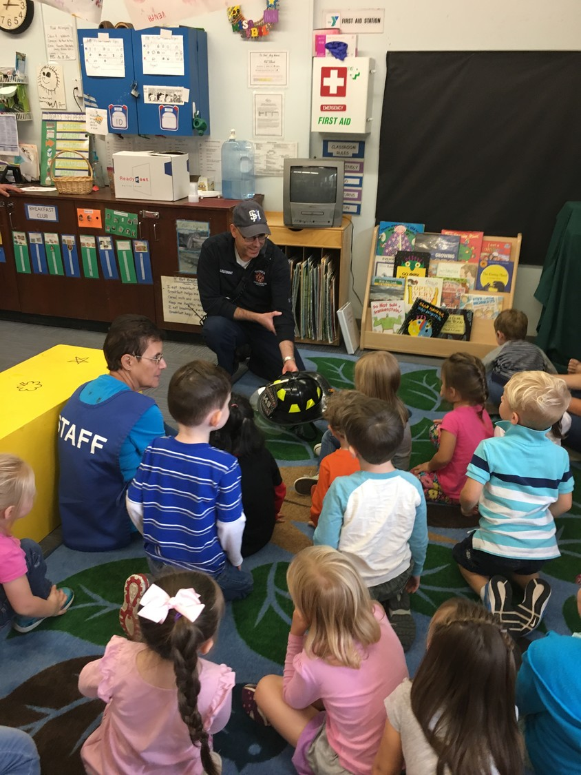 UP CLOSE: Warwick Fire Lt. Chris LeClair gives children a close-up look at a  firefighter's helmet.