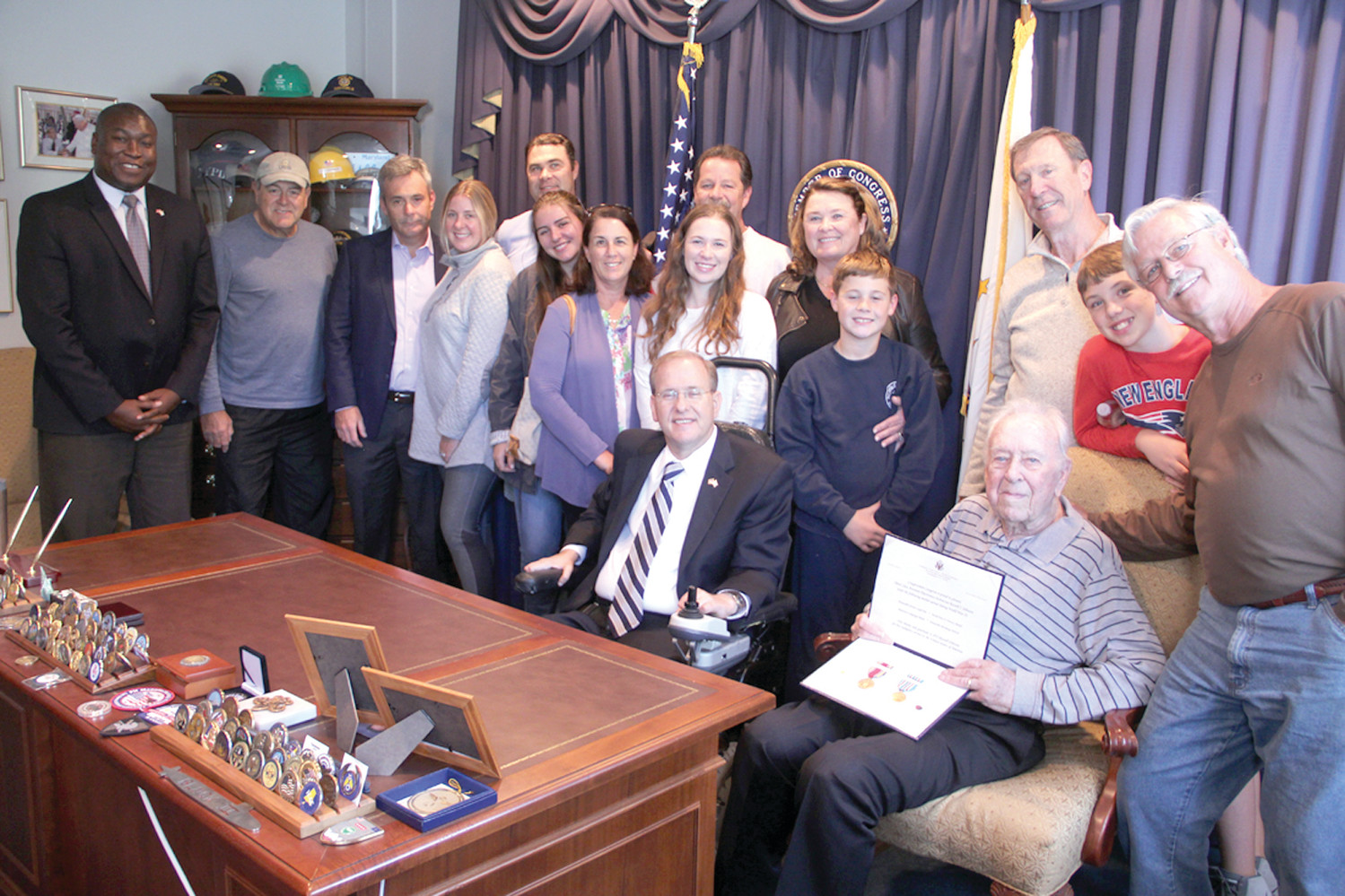 CELEBRATING HIS SERVICE: Congressman Jim Langevin presented WWII medals and awards to Russell Johnson at his office Tuesday. They were joined by members of Johnson's extended family and Rhode Island Director of Veterans Affairs Kasim Yarn at far left.