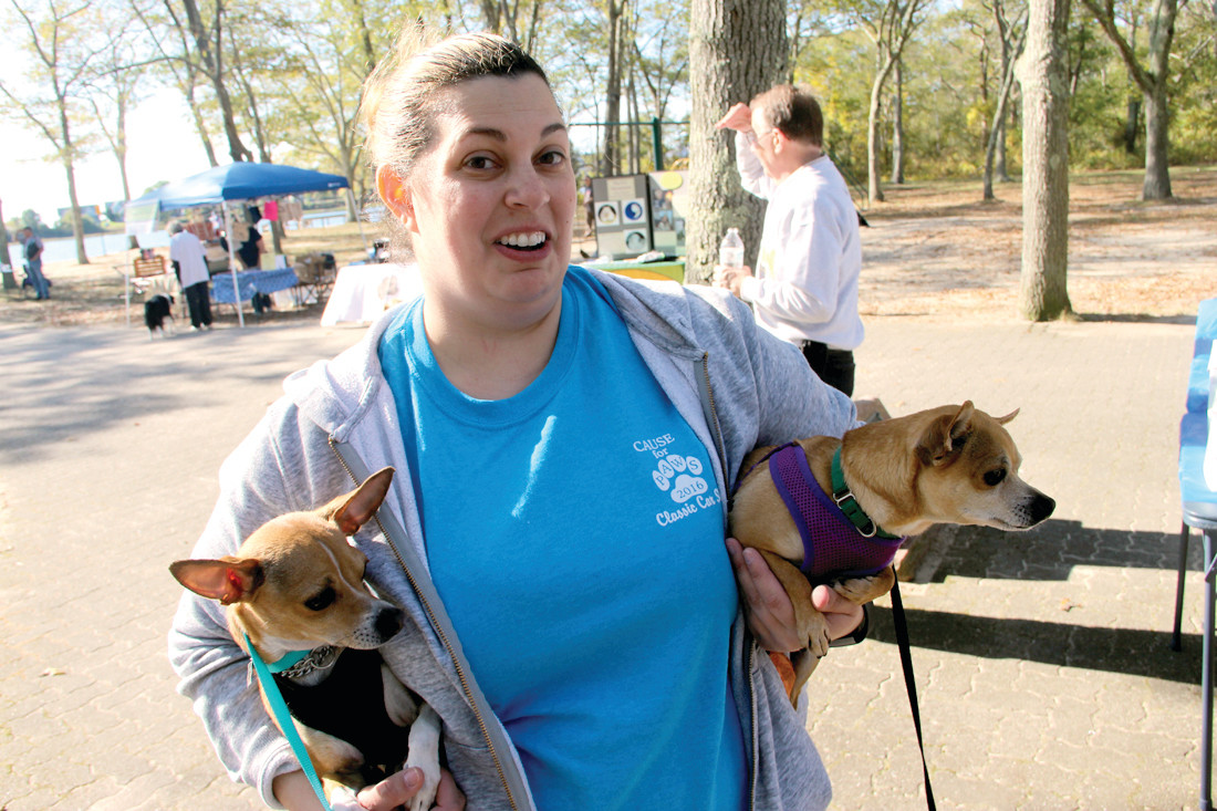 THEY COULD USE A HOME: Jackie Picozzi of the Warwick Animal Shelter carries two of the dogs that are up for adoption.