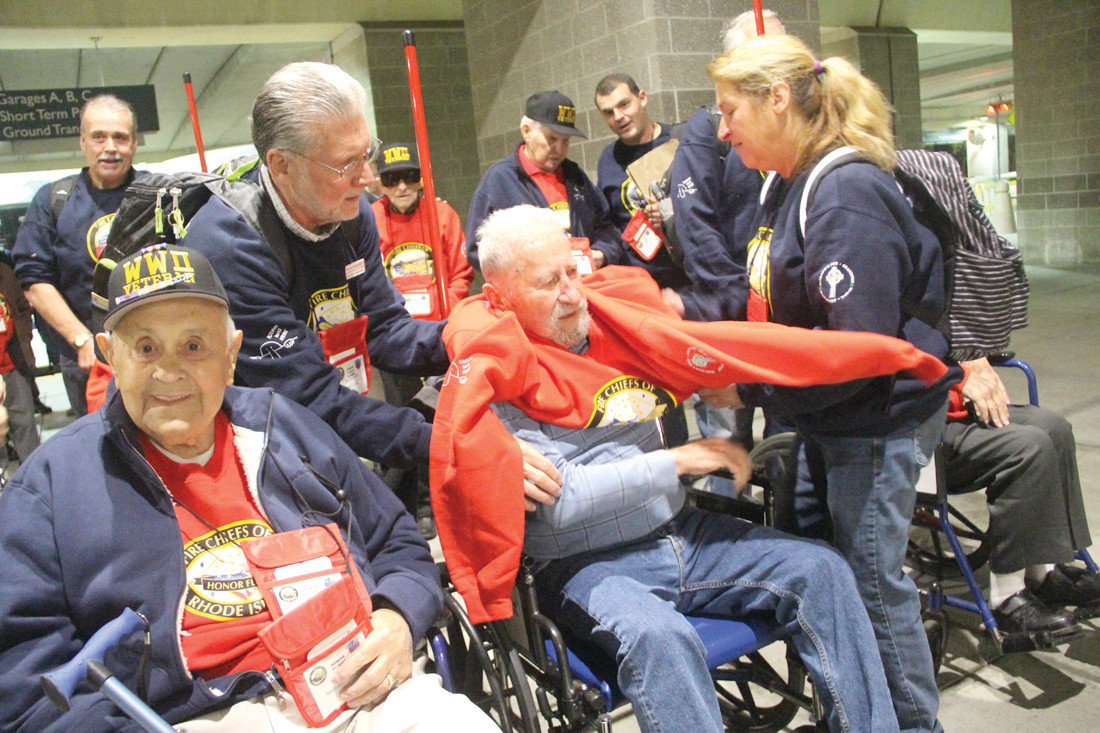 QUICK CHANGE: As one veteran forgot to wear his Honor Flight t-shirt, another was quickly found and the change made before entering the airport terminal.