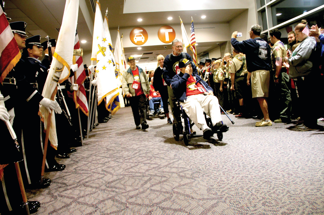 A HERO'S WELCOME: Fire, police and military honor guards greeted the veterans as they entered the terminal.