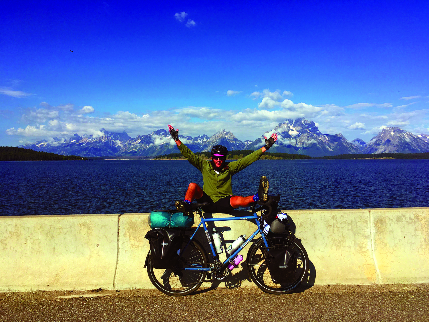 TAKING A BREAK: Jon Wish takes a breather during his cross-country trip at Teton National Park.
