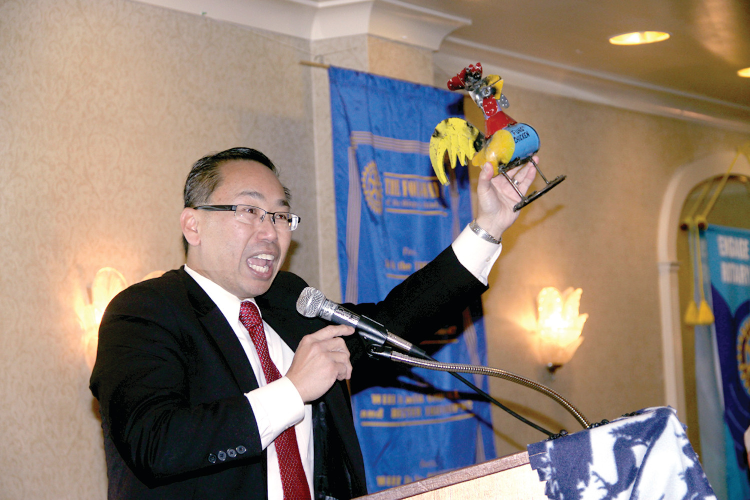 THE CHICKEN ORDINANCE: Cranston Mayor Allan Fung brought along his own props, including a chicken, as he told how both Cranston and Warwick wrestled with a chicken ordinance. He had a chicken hat for Avedisian, but the mayor didn't try it on.