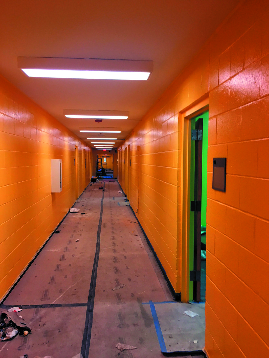 FOLLOW THE YELLOW BRICKED HALL: A bright shade of yellow adorns the main hallway walls of the new branch of the Warwick Boys & Girls Club. The colors were chosen to be kid-friendly.