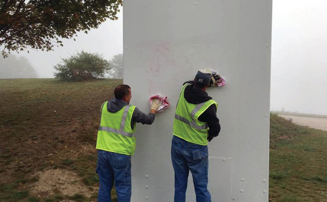 SCRUBBING THE ARCH: Workers tried to scrub off red graffiti on the Rocky Point Arch, a 60-foot tall structure originally displayed at the 1963-64 World's Fair, which was recently completely refurbished.