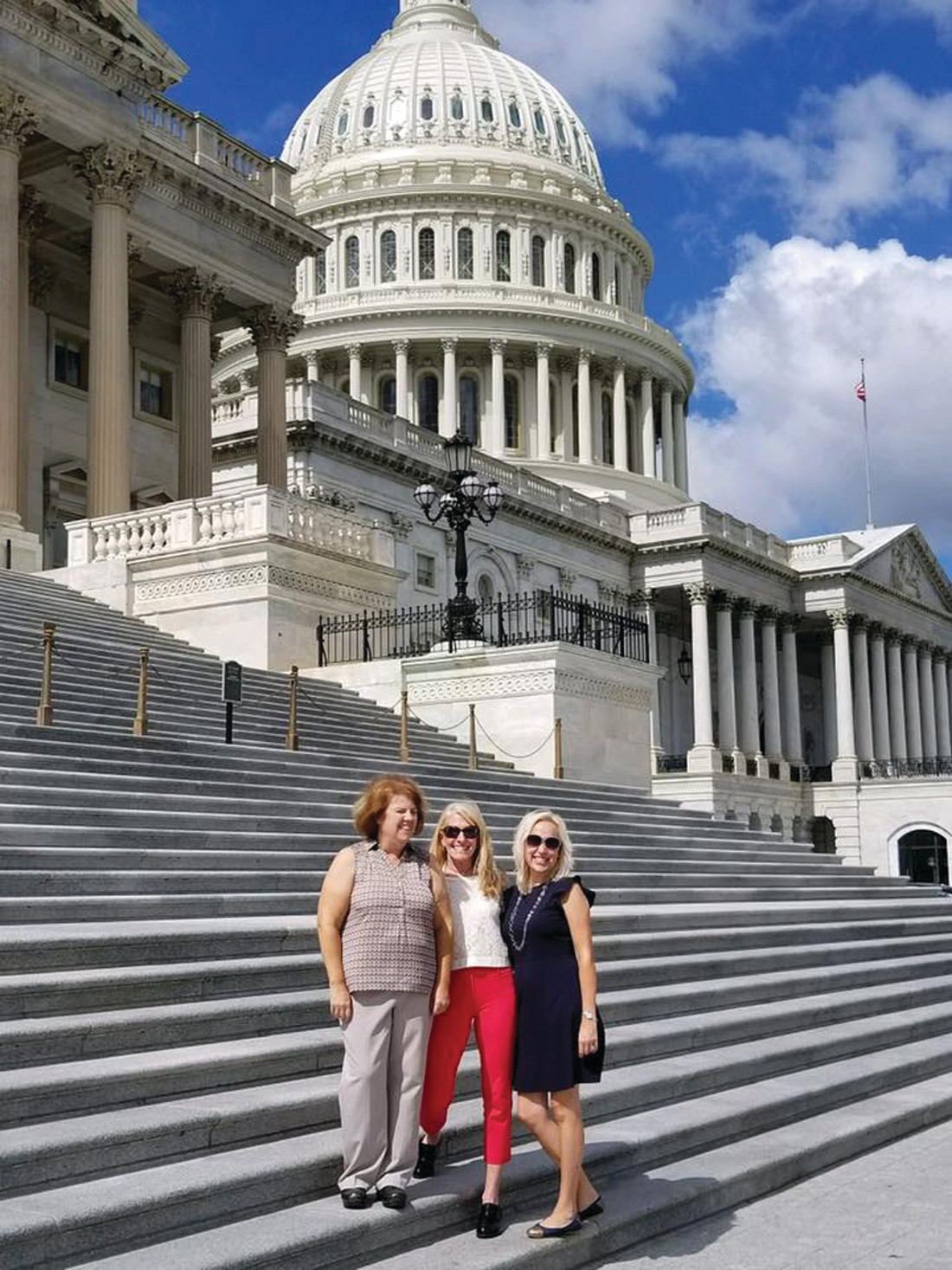 STOPPING AT CAPITOL HILL: Kelley Fluette, Maya Colantuono and Elaine Gabellieri took a moment out of their whirlwind schedule to take a group shot with the Capitol behind them before heading inside to speak to the Rhode Island leaders.