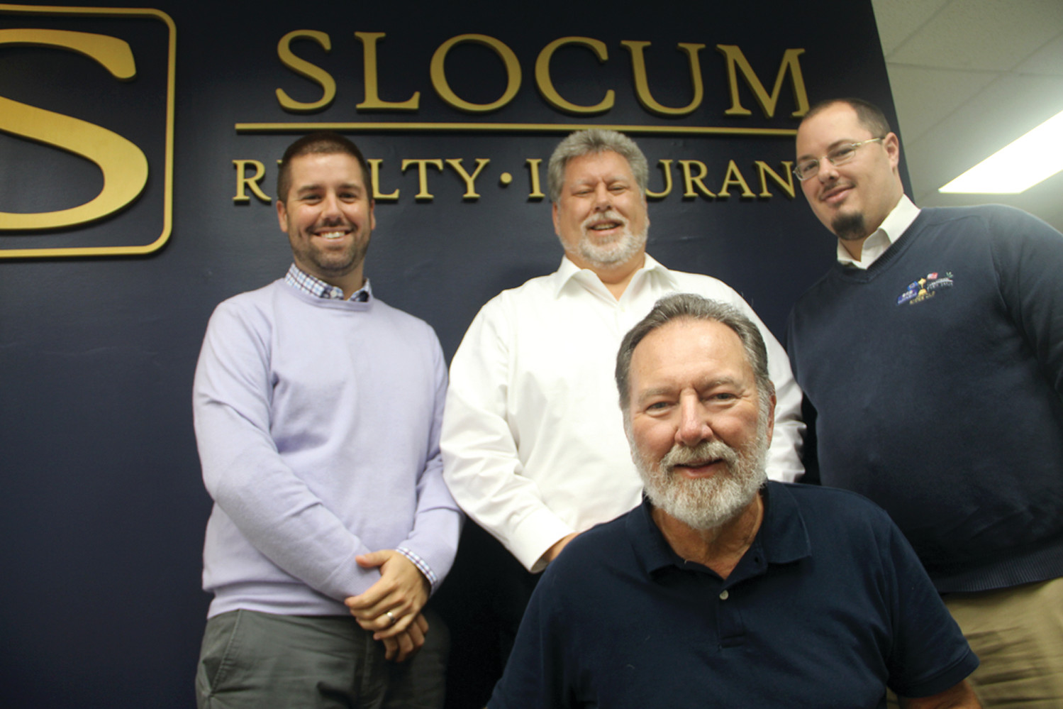 THE SLOCUM TEAM: Looking to further grow The Slocum Agency Inc., Slocum Real Estate has moved to a 5,000-square-foot office building at 333 Centerville Road. From left are Nick Slocum, his father Phil Slocum, Phil's brother Bob Slocum and his son, Christopher.