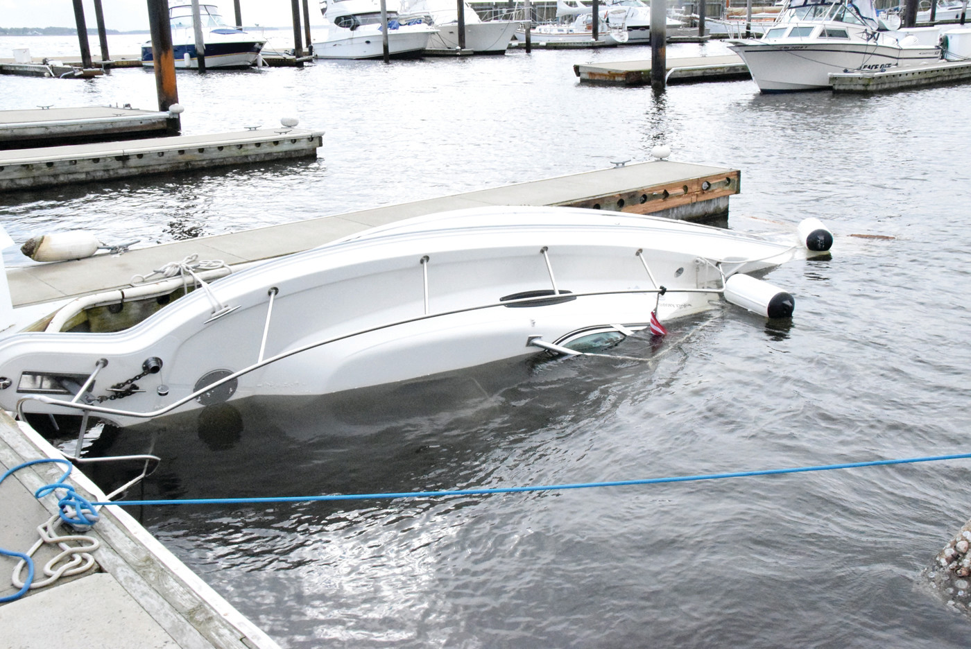 SUNKEN COSTS: A boat sits totally capsized after it broke free of its spring lines in the storm's harsh weather while docked in Greenwich Bay Marina. Many boats that were  improperly tethered suffered serious damage, while those who took proper precuations were able to avoid major damage