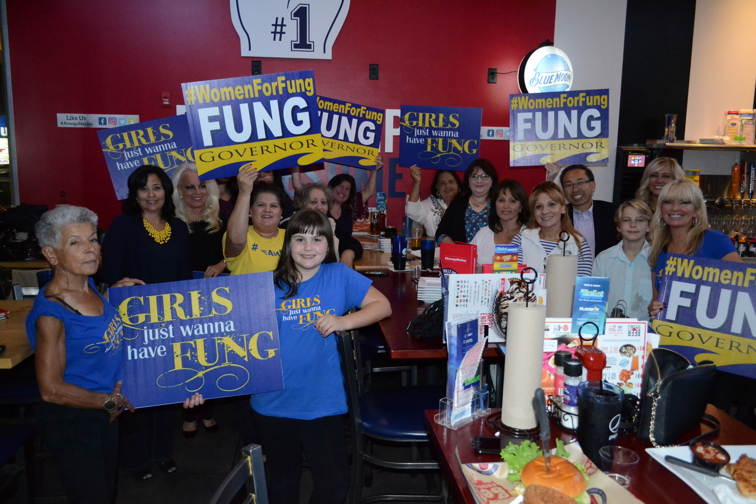 "Cranston Mayor and Republican candidate for governor Allan Fung (to the right, in the back), gathered with female supporters at Arooga's in Warwick last Thursday evening for a campaign event dubbed ""Girls Just Wanna Have Fung."""