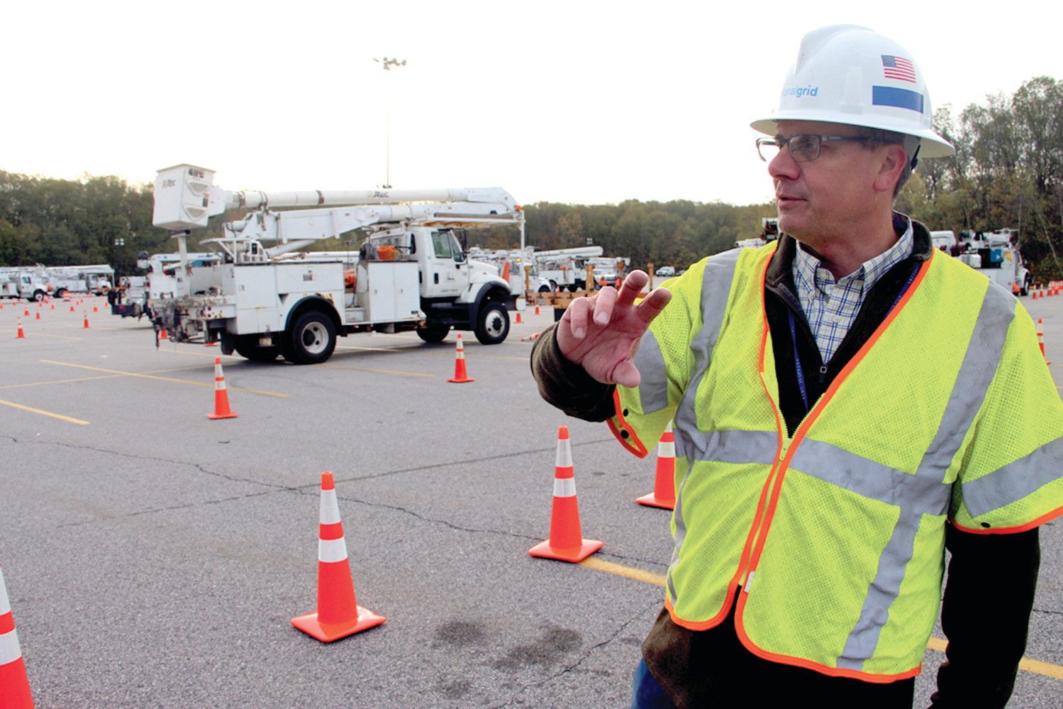 STAGED AND DEPLOYED: Gary Lataille, a member of National Grid's emergency planning, at the staging area for out-of-state crews at CCRI in Warwick Wednesday, where they were deployed to restore power throughout the state.