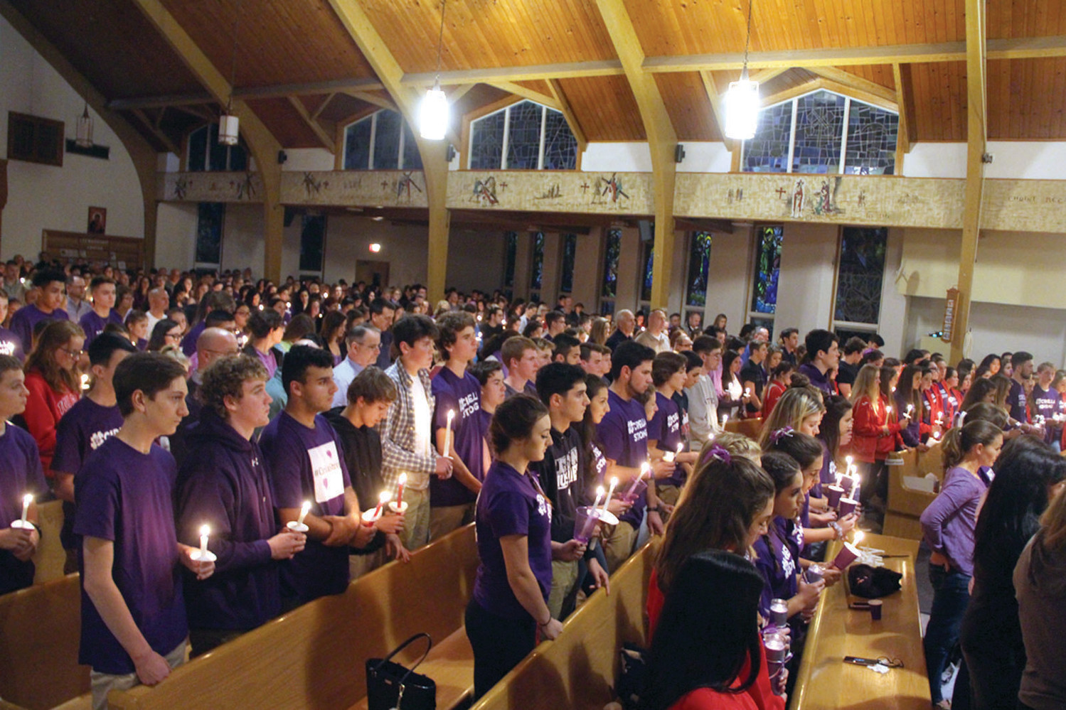 LIGHTS FOR CIRELLA: St. Gregory the Great Church in Cowesett was filled for Friday's vigil for 16-year-old Gianna Cirella, who died last Wednesday.