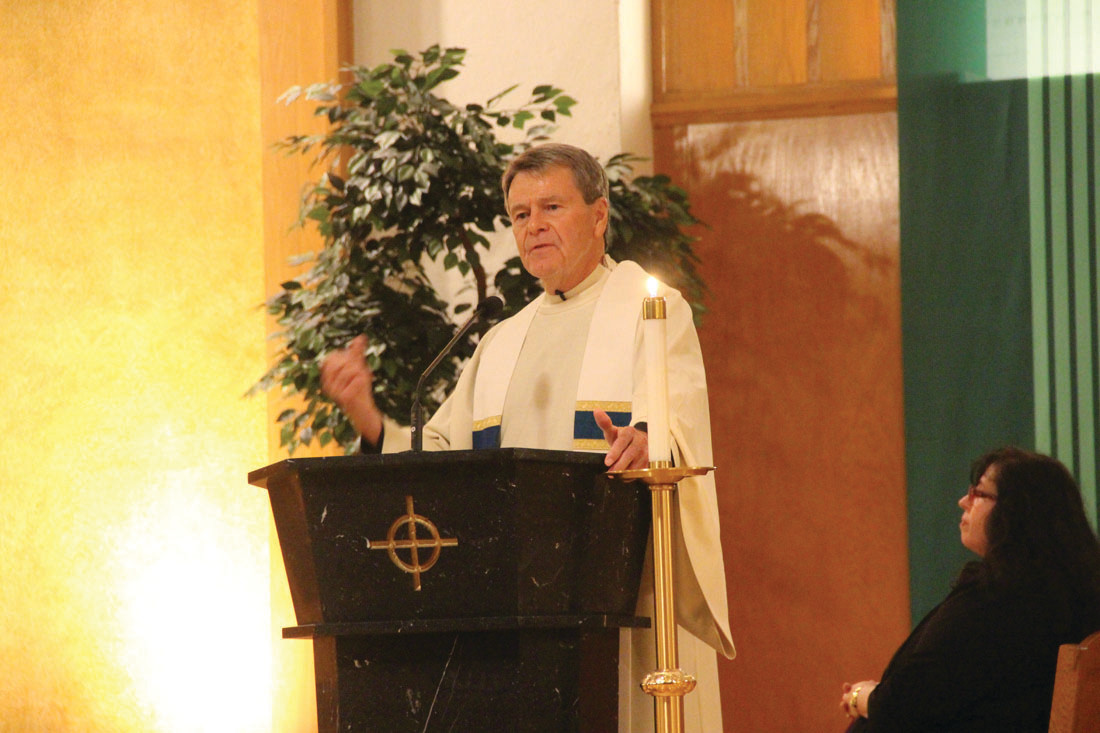 VIGIL CELEBRANT: Father David Ricard addressed the hundreds who gathered for Friday's vigil.