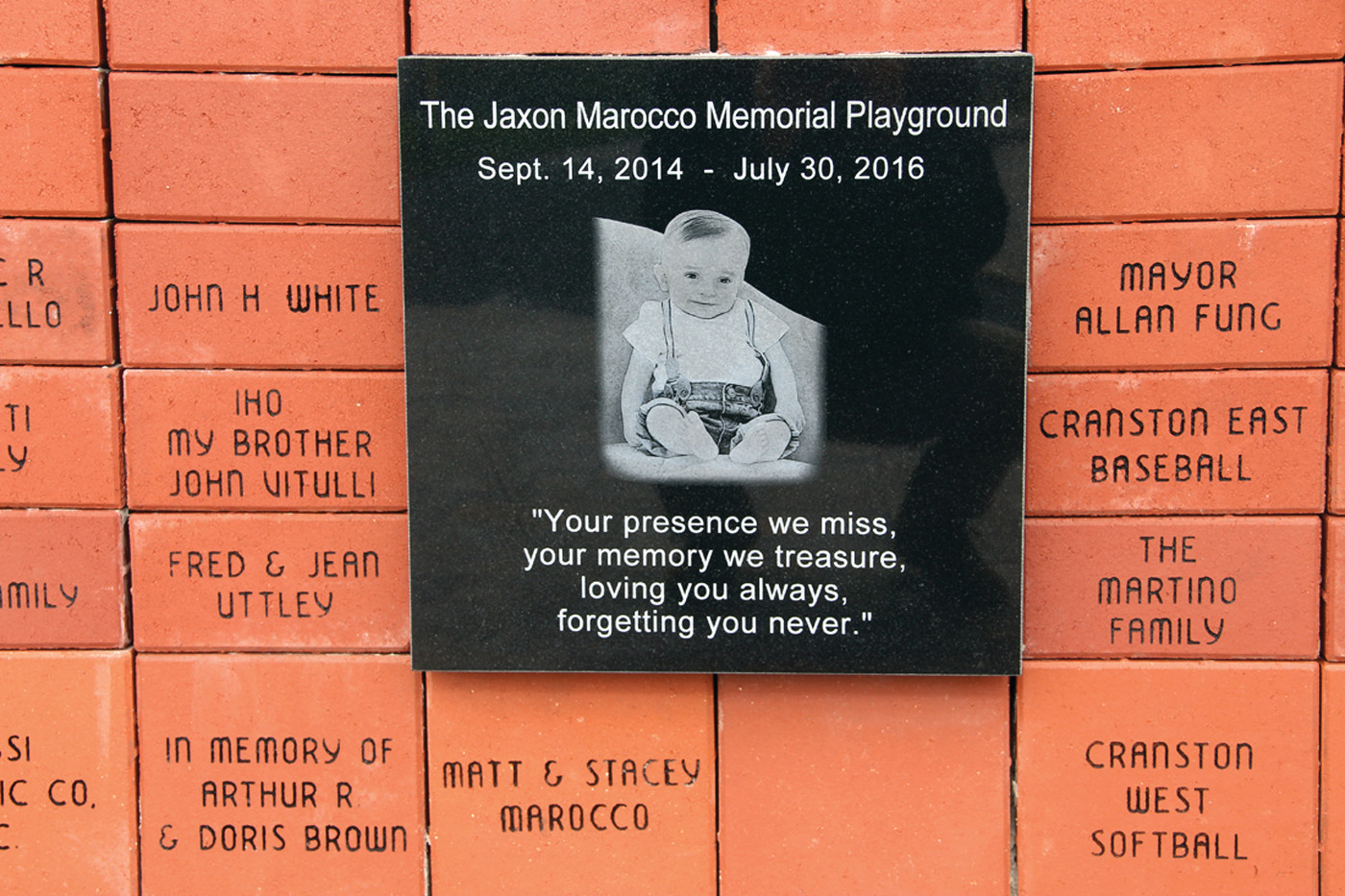 FOR JAXON: The bricks, which were sold to help fund the building of the playground, are set up in front of the playground and center around a plaque to memorialize the late Jaxon Marocco.