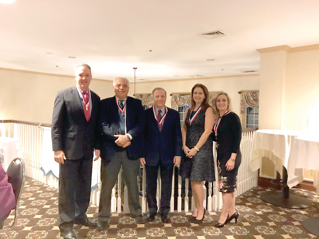 THE 37TH CLASS MEMBERS: The newly inducted members of the Cranston Hall of Fame (from left) Douglas H. Sherman Jr., Ed.D., Charles H. Lonardo, Esq., William J. Turtle, MD, Karen A. Santilli and Robin Melfi Coia pose at the Valley Country Club on Friday, November 3.