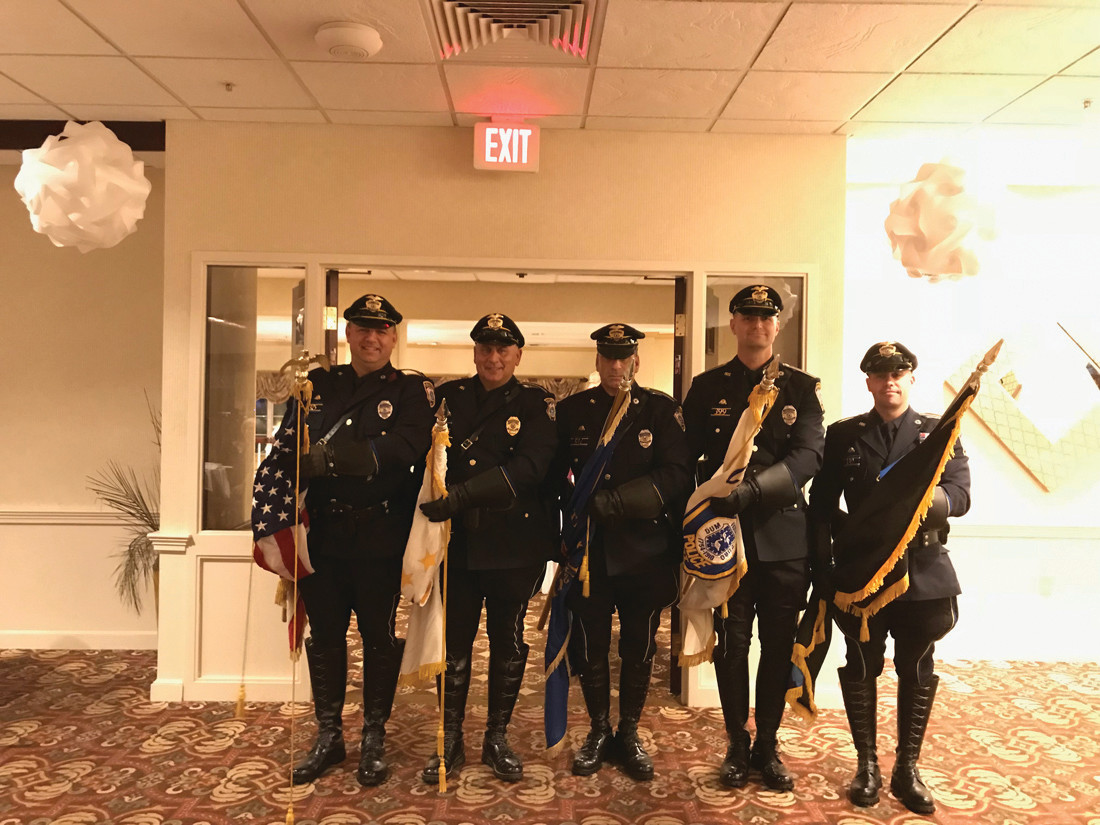 TO SERVE AND PROTECT: Members of the Cranston Police Honor Guard prepare to escort the inductees at the Cranston Hall of Fame ceremonies.