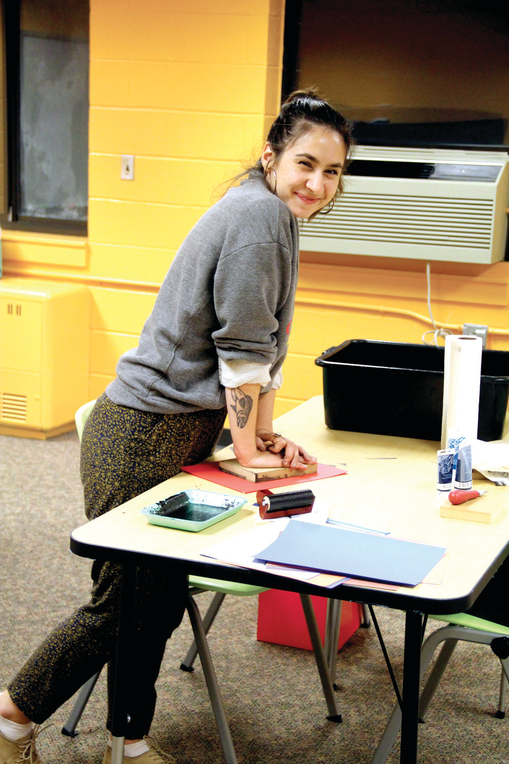 ART IN THE MAKING: Rachel Abimerhi, who will be teaching art at the new club, demonstrates doing a woodprint.