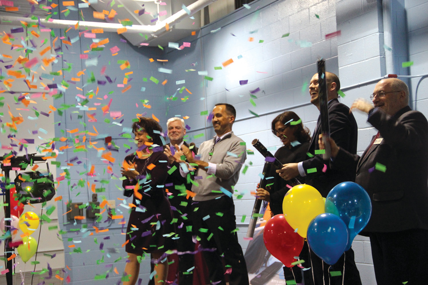 NO RIBBONS HERE: Lara D'Antuono insisted on not having a regular, boring ribbon cutting to celebrate the opening of the new branch of the Warwick Boys & Girls Club on Tuesday night. Instead, she opted for four of the club's biggest benefactors to fire confetti cannons.