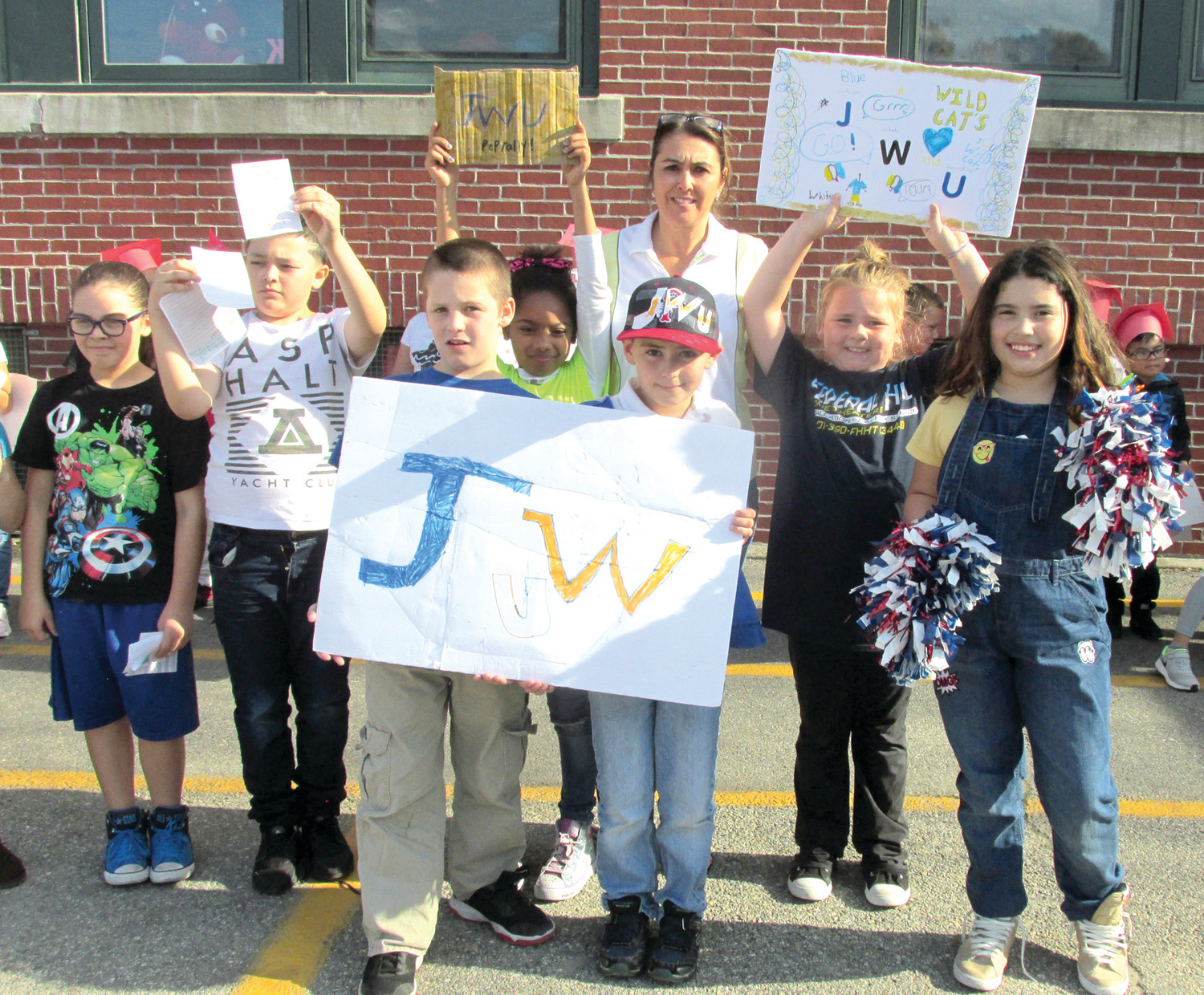 REGO'S ROOTERS: Johnson & Wales University was the college of choice for Ms. Rego's Grade 3 class that was among the fun-filled teams at last Friday's College Pep Rally at Thornton School.
