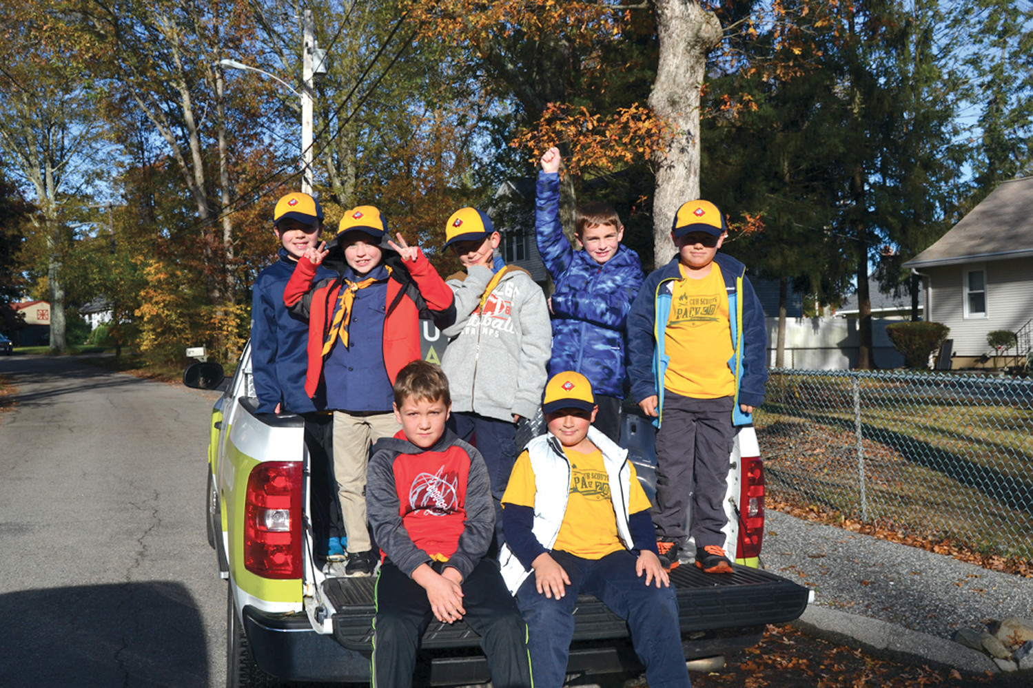 PICKUP IN A PICK-UP: Cub Scouts of Pack 20 hit the neighborhoods surrounding Oak Swamp on Saturday, running from house to house and placing donations in the back of a pick-up truck.