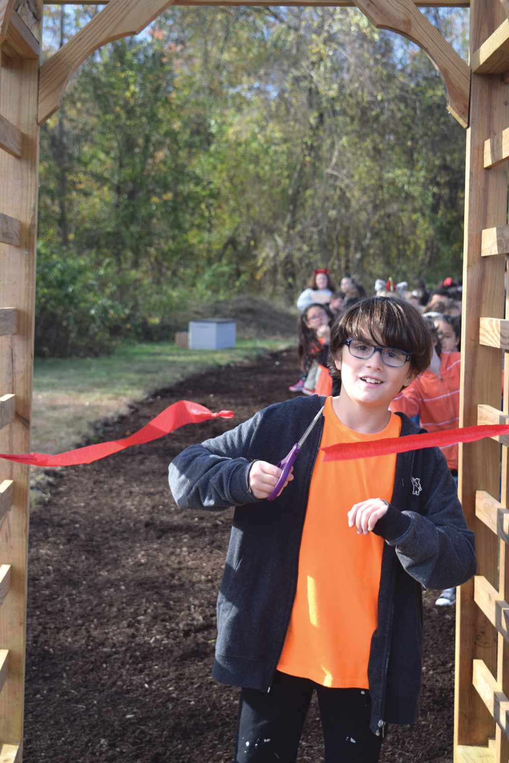 OFFICIALLY OPEN FOR LEARNING: Jonas Littlefield cuts the ribbon, officially opening the outdoor habitat for generations to come. (Submitted photo courtesy of Sarah Dyer Barnes Elementary School)