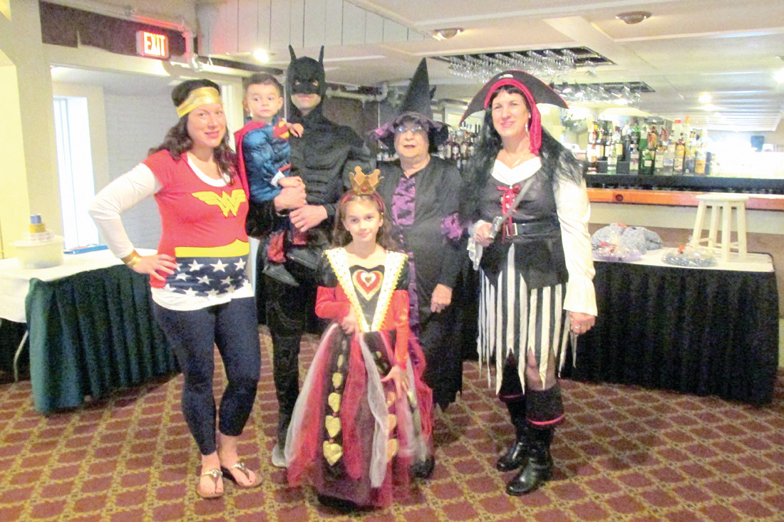 "CLASSIC CREATIONS: Manton Seniors President Lori ""The Nicest Witch Around"" DeVito is joined by her family members who came to the senior citizens Halloween Dinner/Dance Sunday dressed in a variety of classic and colorful costumes."