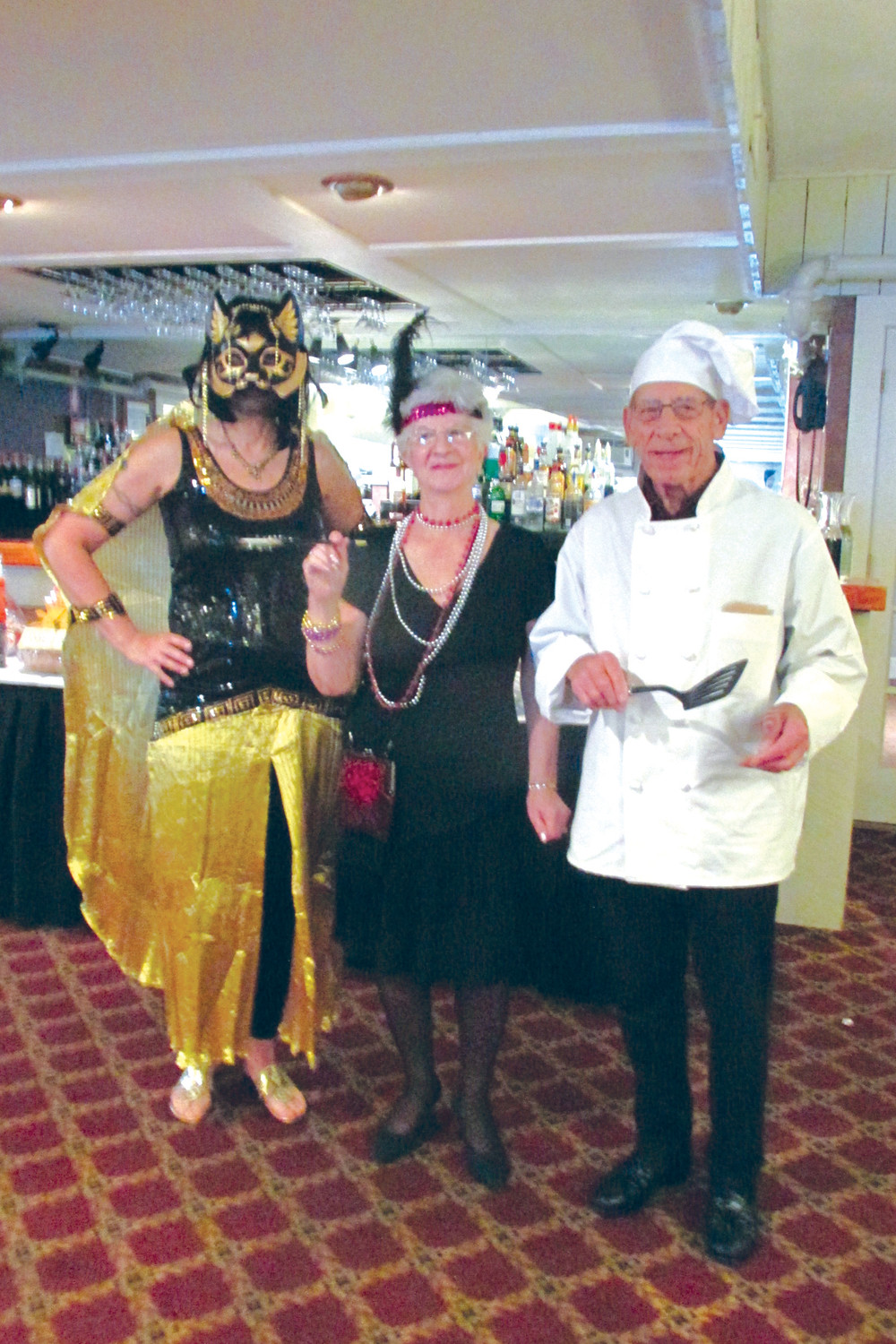 GRAND GARB: Manton Seniors members Naomi Simmons, Rose Coppola and Bob Tetreault Sr. were among those folks who dressed special for Sunday's Halloween Dinner/Dance.