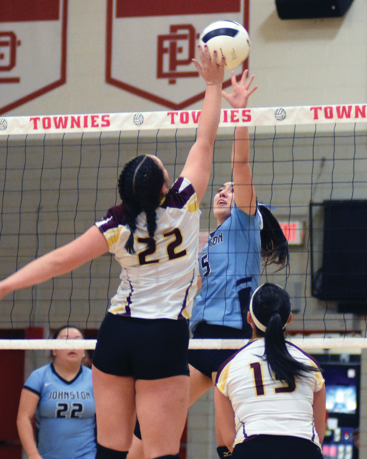 CHAMPIONSHIP MATCH: Johnston's Gabby DiRaimo tries to block a shot at the net.