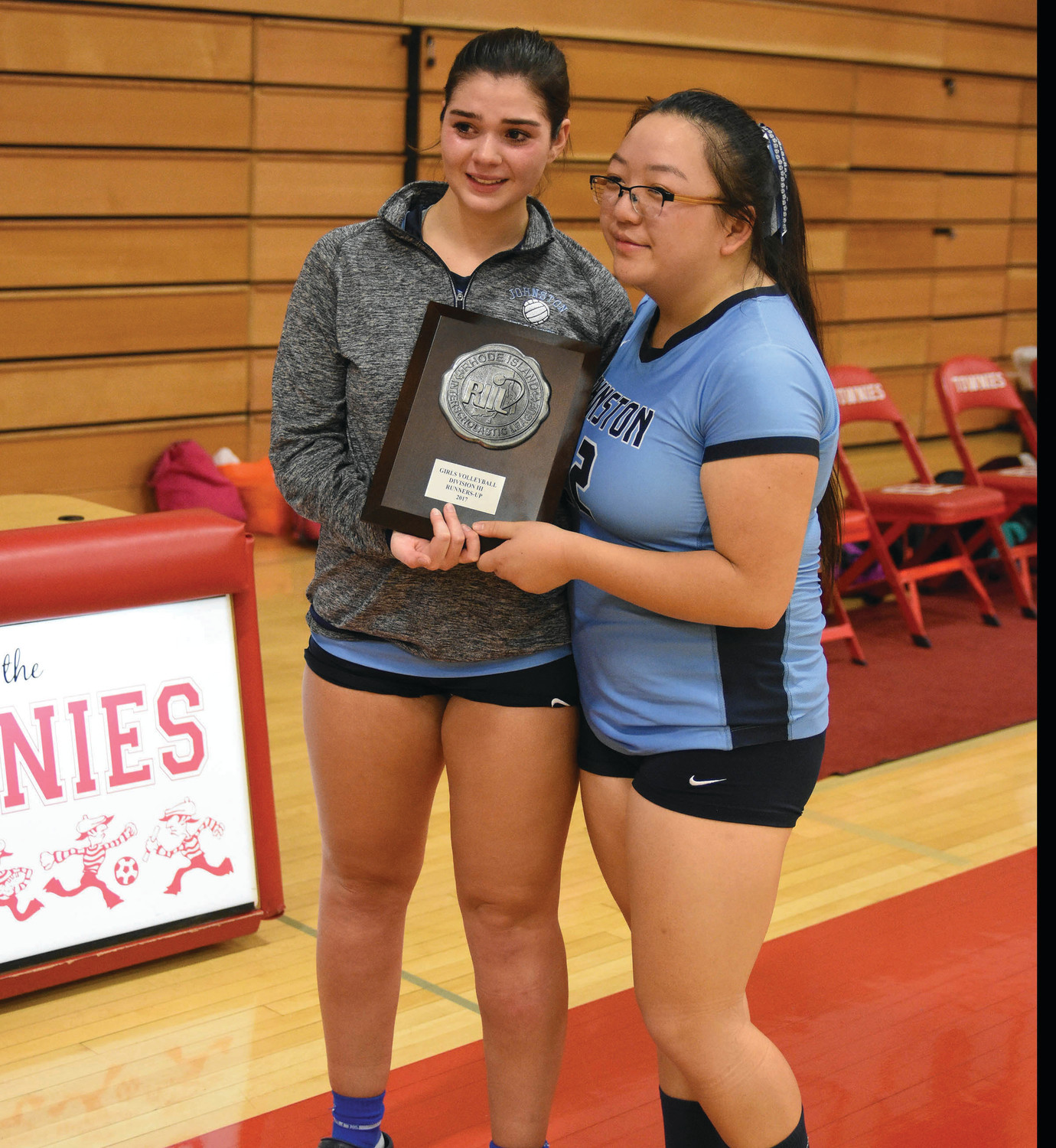 Alyssa Johnson and Maikou Kue receive the Panthers' runner-up plaque.