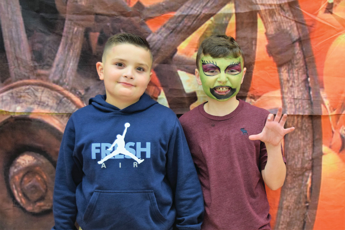 DIFFERENT LOOKS: While Jaiden Weston opted for a face free look, his brother Jordan Weston had his face painted during the recent Winsor Hill School Harvest Night.