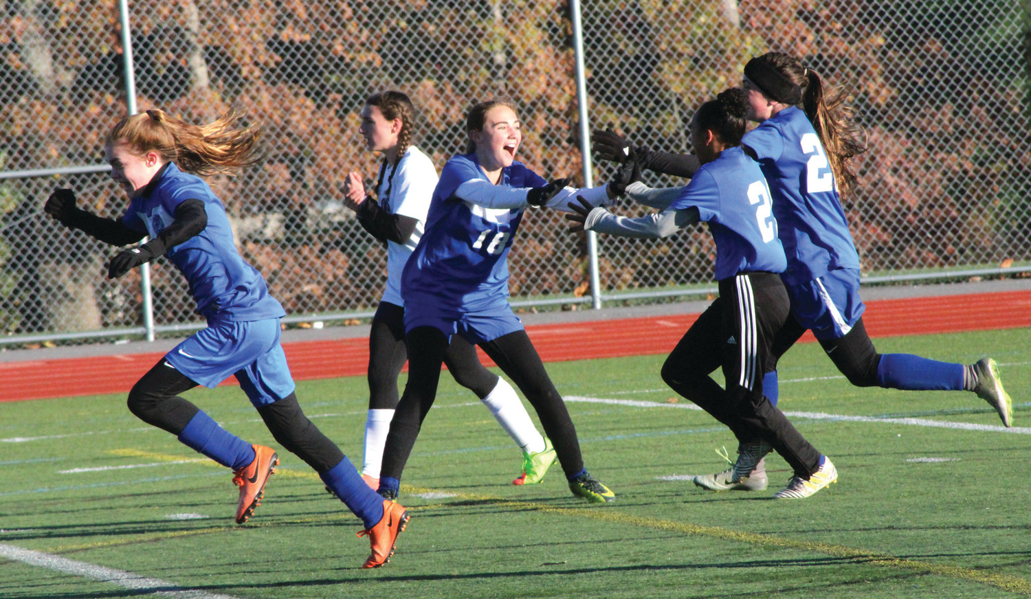 Amelia Murphy (18) celebrates her second half goal with teammates.