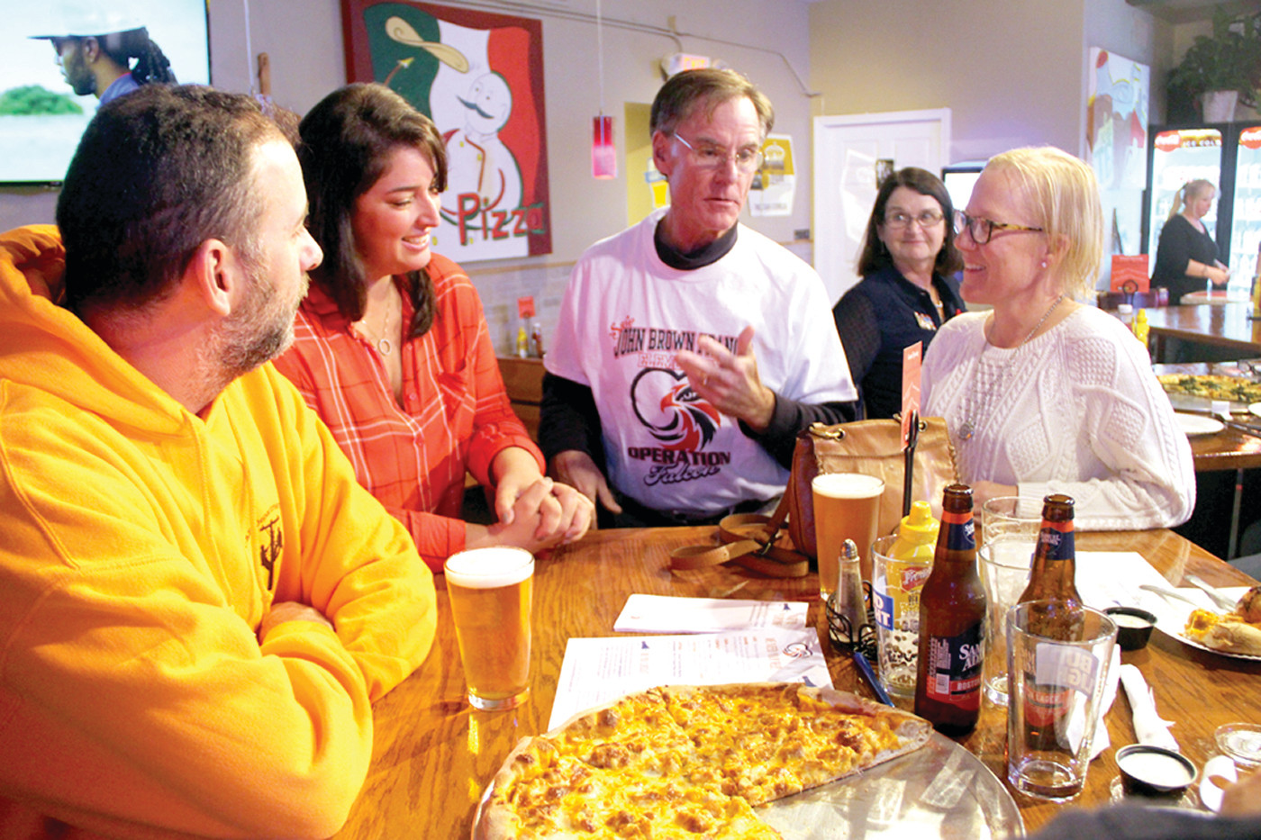PLANS AND PIZZA: Members of Operation Falcon, a group working to save John Brown Francis School from being re-purposed as the city's early childhood center, met at Palazzo's Pizza Thursday. From left: John Dmato, Vanessa Carnevale, Councilman Richard Corley and Mary Martin.