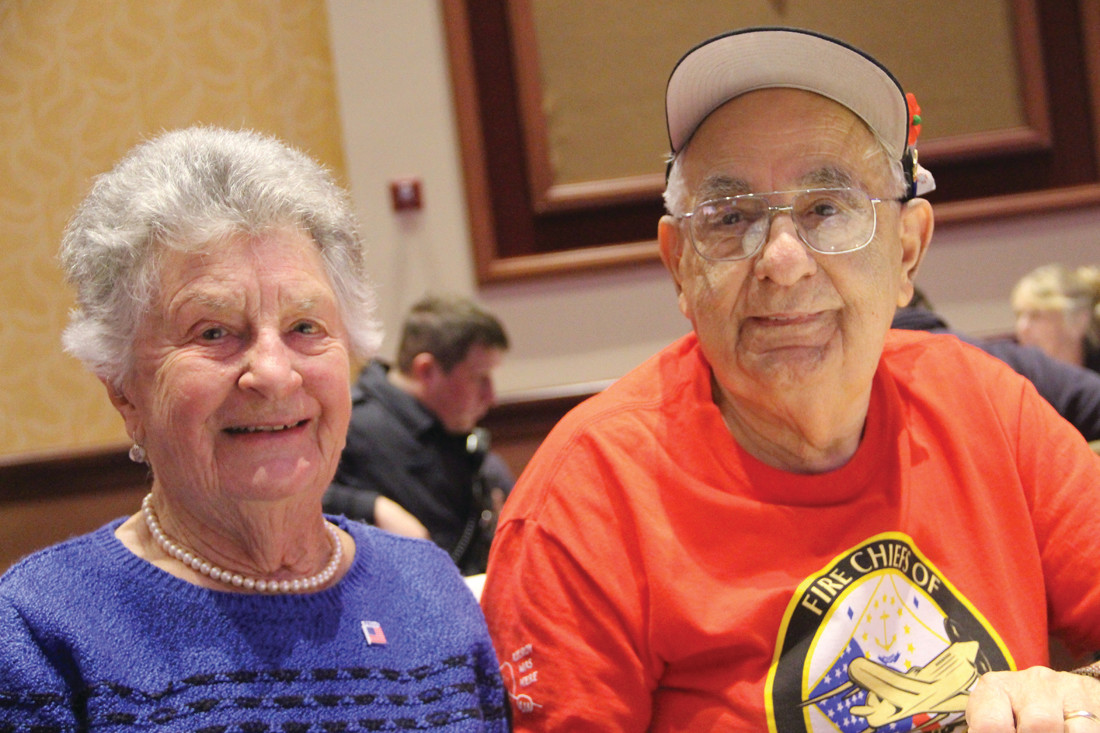 MAKING CONNECTIONS: Betty Law joined Korean War veterans Giovanni Migliaccio at A Veterans Day of Honor observance conducted by the Rhode Island Fire Chiefs Honor Flight at Twin River on Sunday.
