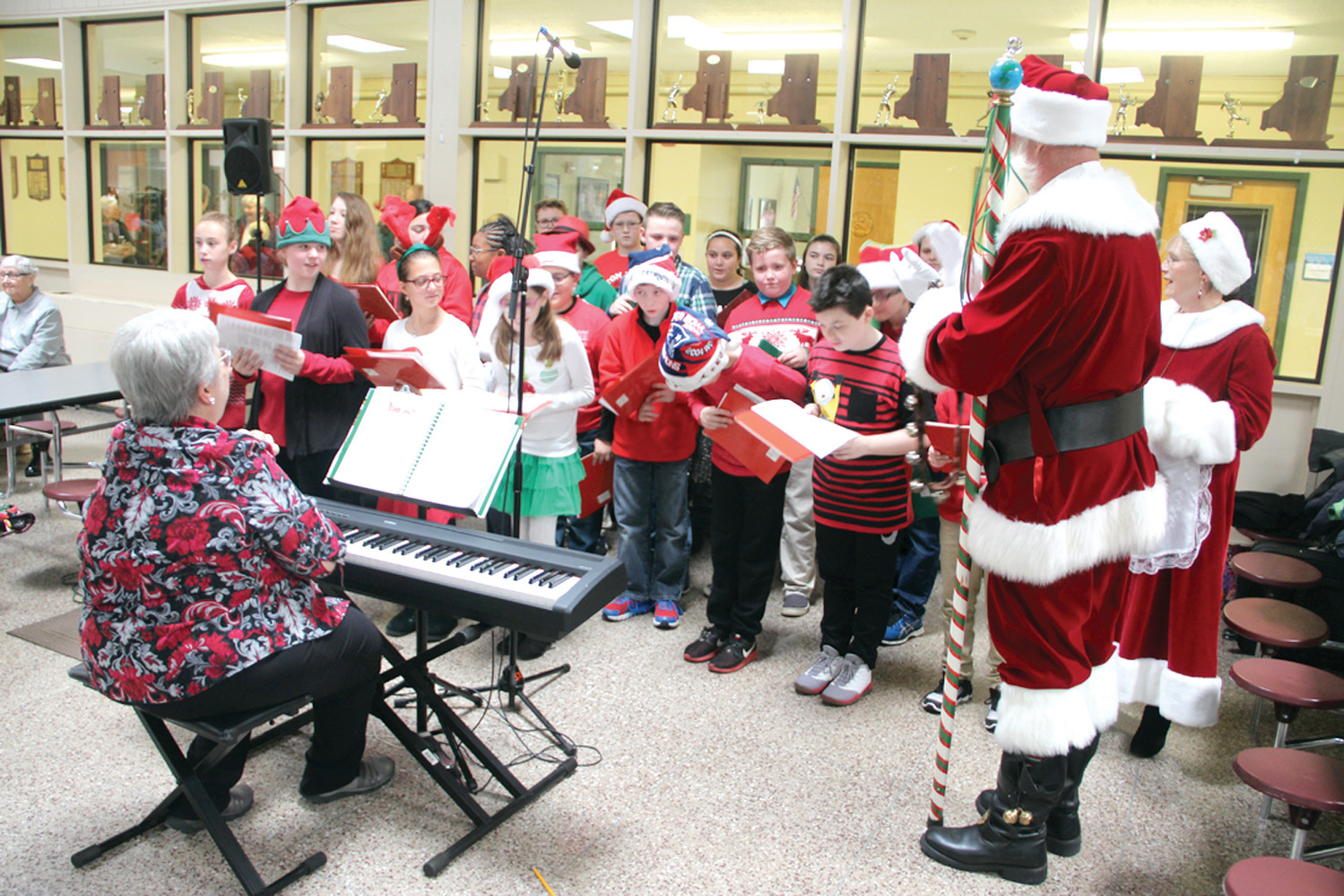 HE JOINED THE CHORUS: Santa and Mrs. Claus sang along with the St. Kevin School Chorus. Accompanying the chorus was Bev Hopkins, who made sure to play some Christmas favorites – whoever said it's too early to ride in a one-horse sleigh?