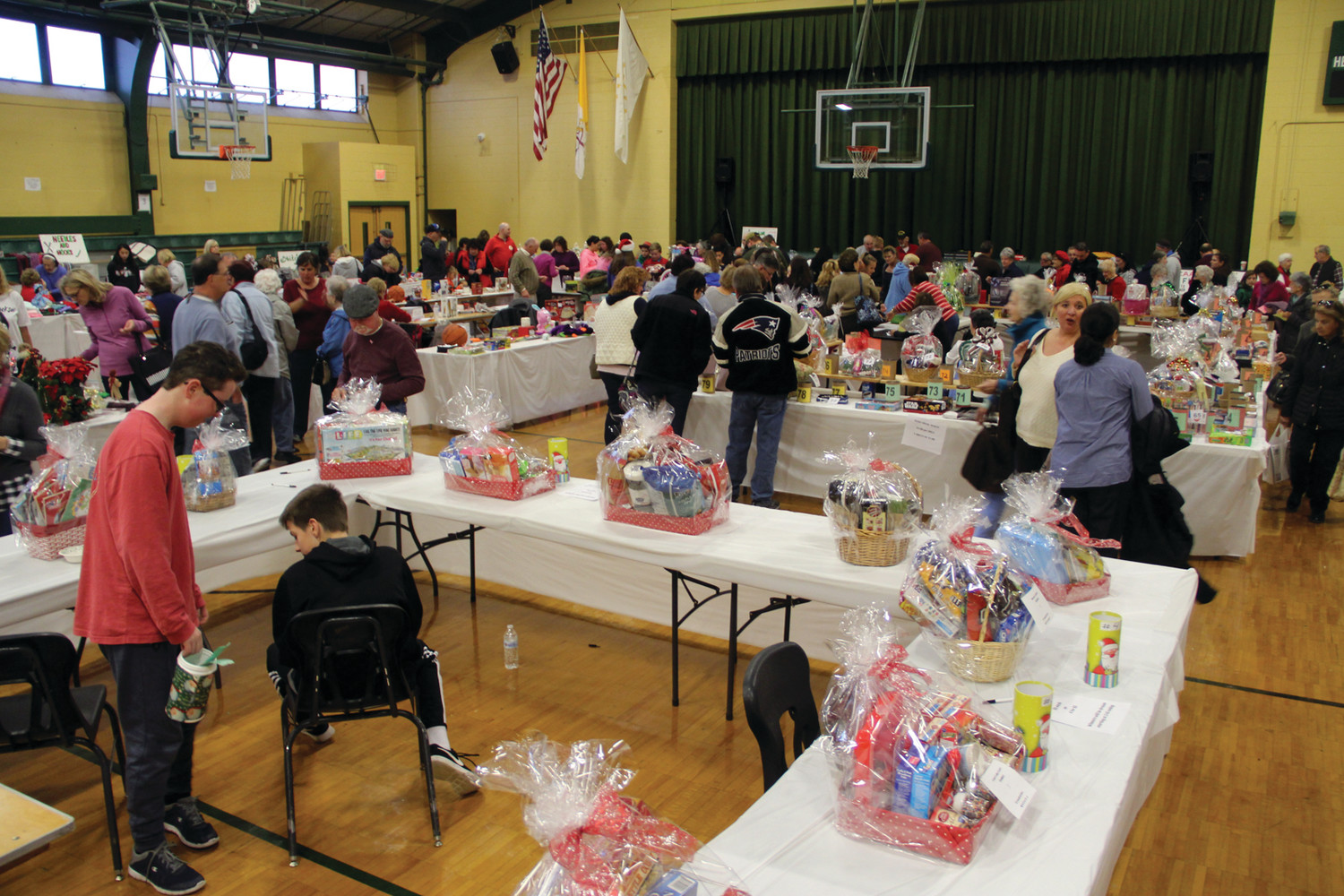 A FULL GYM: There was surely something for everyone at the St. Kevin Church Christmas Bazaar that filled both the gym and cafeteria at Hendricken.
