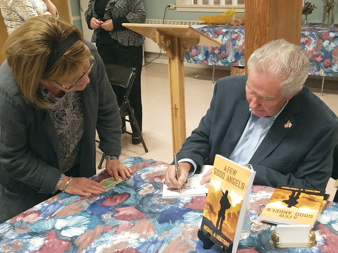 READ MORE ABOUT IT: Montigny autographs one of his books for a parishioner at St. David's-on-the-Hill.