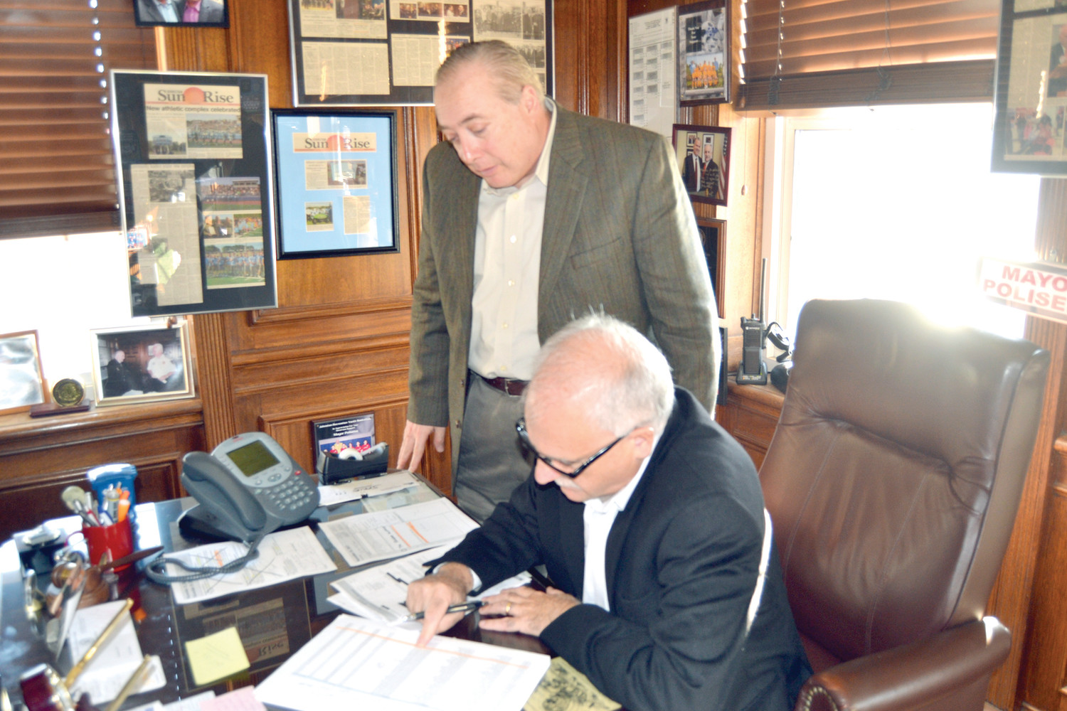 THE TAXMAN COMETH: Mayor Joseph Polisena and Johnston Finance Director Joseph Chiodo review the list of outstanding car taxes owed to the town.