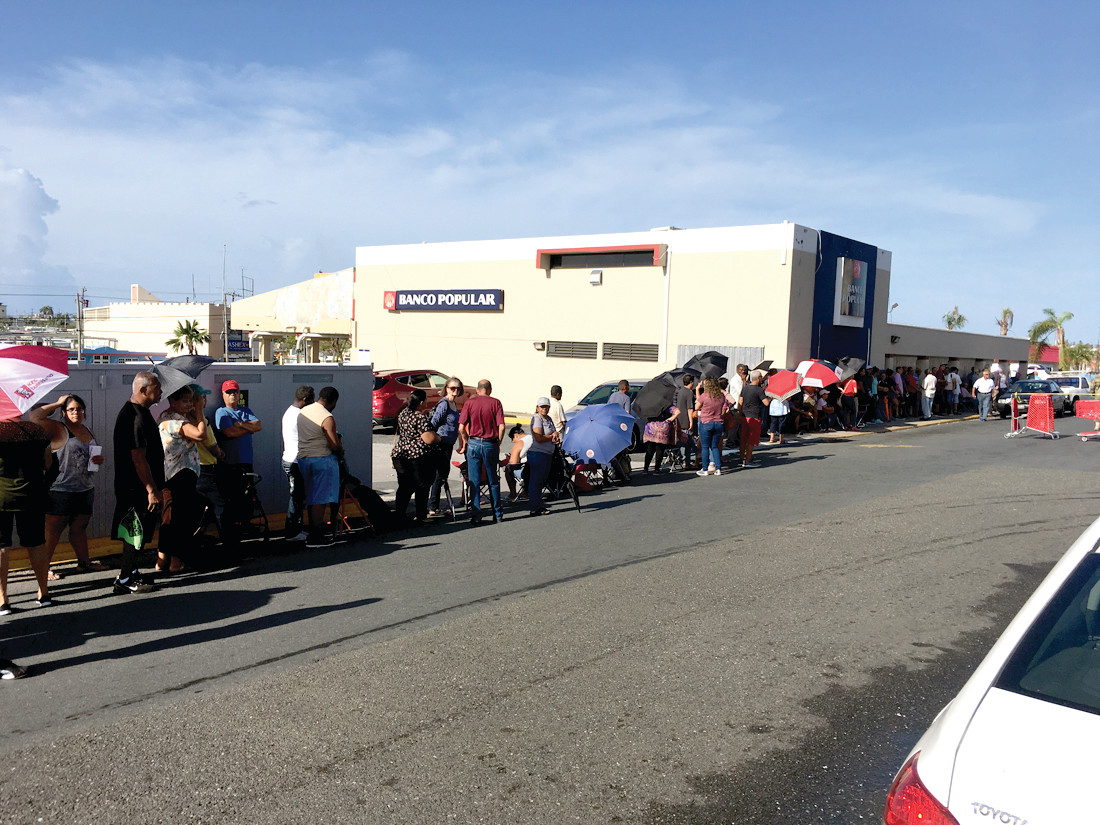 LINED UP: Even weeks after the hurricane, there are long lines for food, gasoline and water.