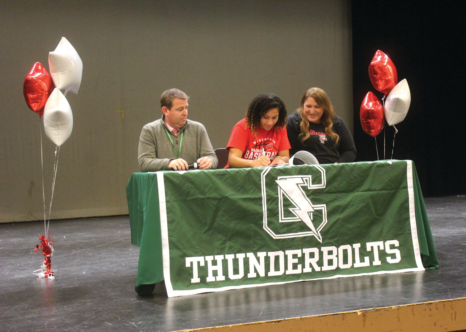 East's Maia Caito signs her National Letter of Intent with Wisconsin last Thursday.