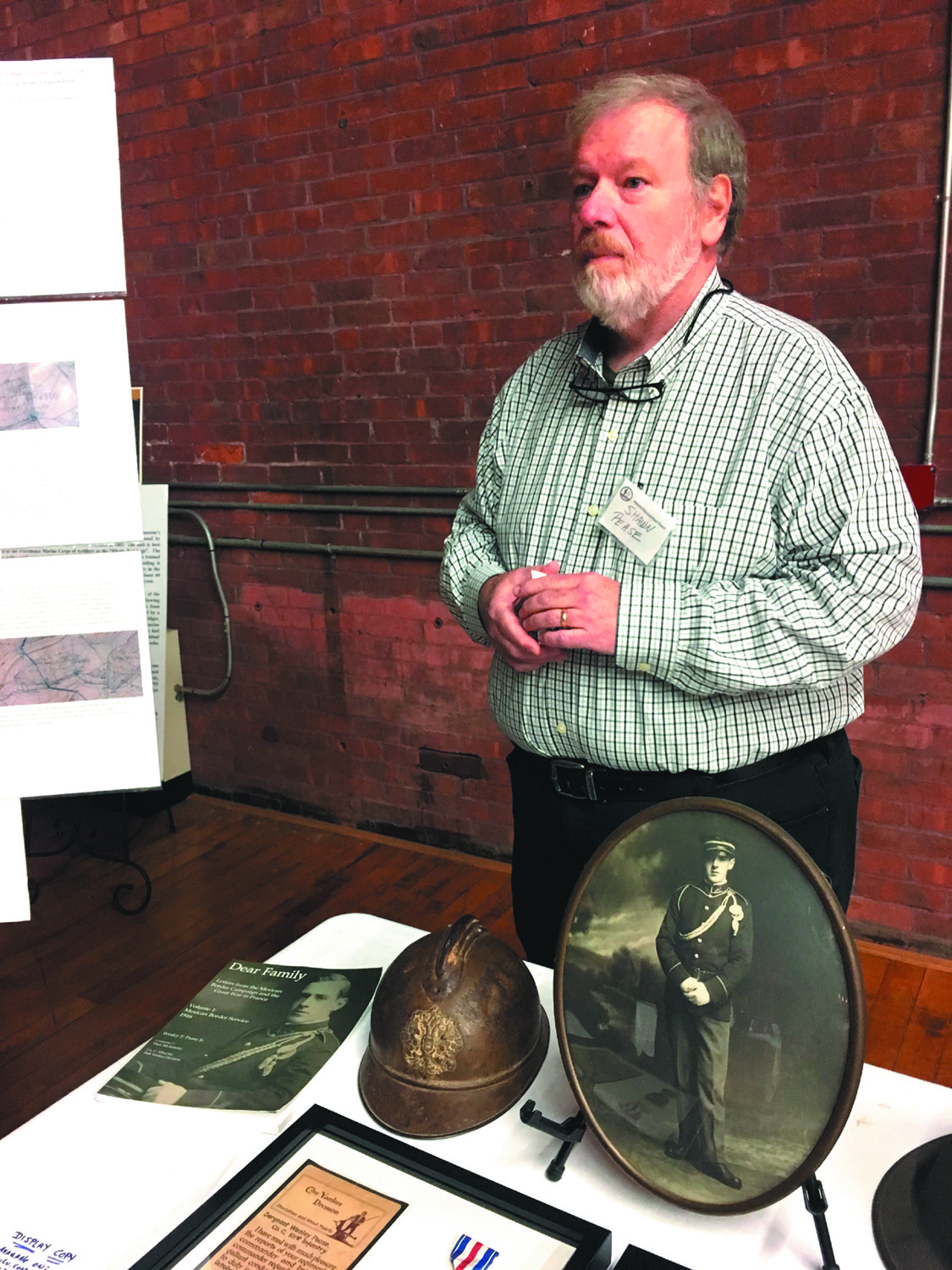 LETTERS FROM THE FRONT: Shawn Pease of Seekonk, Mass. presents his grandfather's history at the Armory on Friday night.