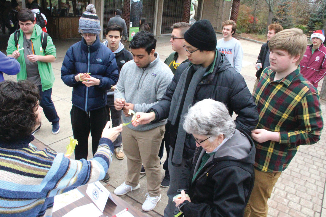 SIGNING UP: Members of the Hendricken Academic Decathlon team, winners of the 2017 competition that went on to win their division in the nationals, gather outside the zoo in preparation for their visit Saturday.